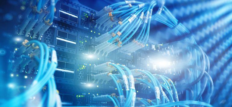 Close_up_fiber_optic_and_hub_in_server_room