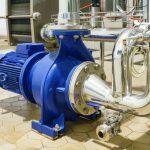 Water_Centrifugal_pump_and_motor_line_with_pipe_rack_in_power_plant_construction_site_industrial,_demineralized_water