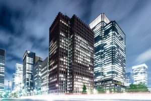 modern_buildings_near_road_in_midtown_of_tokyo_at_twilight