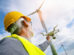 Drone_operated_by_construction_worker_inspecting_wind_turbine,_flying_with_drone.