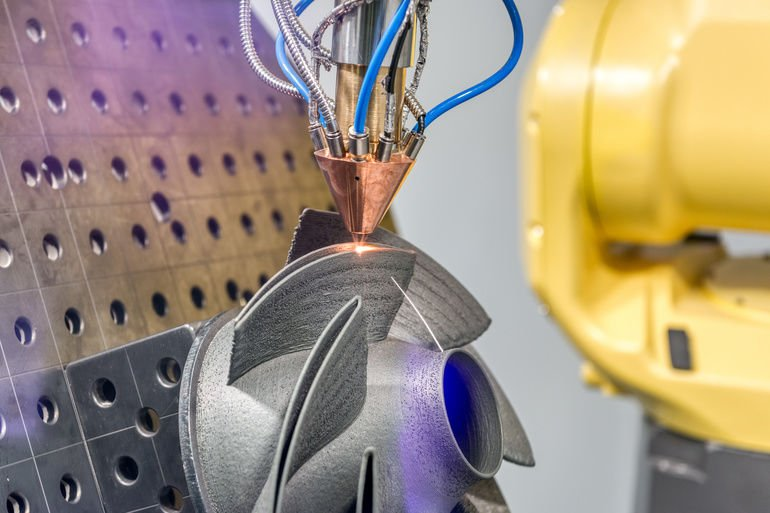 3D_metal_printer_produces_a_steel_part._Revolutionary_additive_technology_for_sintering_metal_parts._Soft_focus.